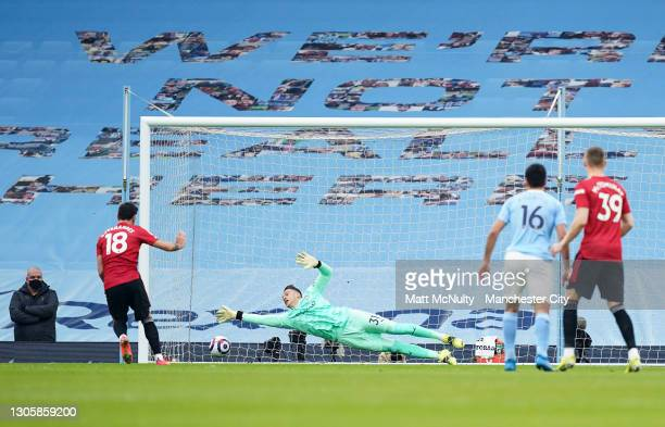 Bruno Fernandes of Manchester United scores a penalty past Ederson of Manchester City during the Premier League match between Manchester City and...