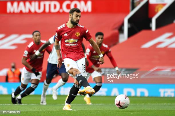 Bruno Fernandes of Manchester United scores his sides first goal from the penalty spot during the Premier League match between Manchester United and...