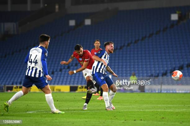 Bruno Fernandes of Manchester United scores his sides second goal during the Premier League match between Brighton Hove Albion and Manchester United...
