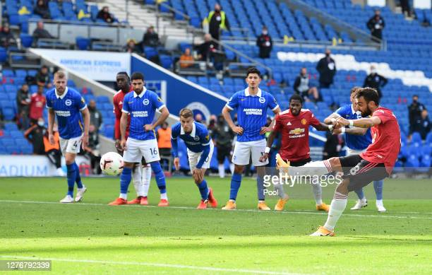 Bruno Fernandes of Manchester United scores his sides third goal from the penalty spot during the Premier League match between Brighton & Hove Albion...