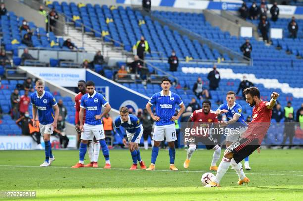 Bruno Fernandes of Manchester United scores his sides third goal from the penalty spot during the Premier League match between Brighton Hove Albion...