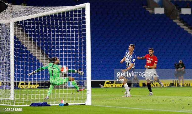 Bruno Fernandes of Manchester United scores his sides third goal during the Premier League match between Brighton & Hove Albion and Manchester United...