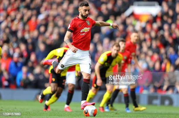 Bruno Fernandes of Manchester United scores his teams first goal from a penalty during the Premier League match between Manchester United and Watford...