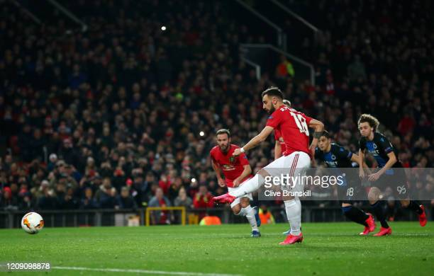 Bruno Fernandes of Manchester United scores his team's first goal from the penalty spot during the UEFA Europa League round of 32 second leg match...