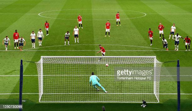 Bruno Fernandes of Manchester United scores his team's first goal from the penalty spot past Hugo Lloris of Tottenham Hotspur during the Premier...