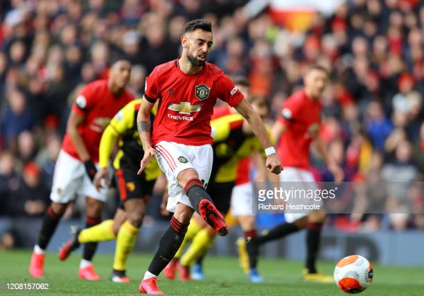 Bruno Fernandes of Manchester United scores his team's first goal during the Premier League match between Manchester United and Watford FC at Old...