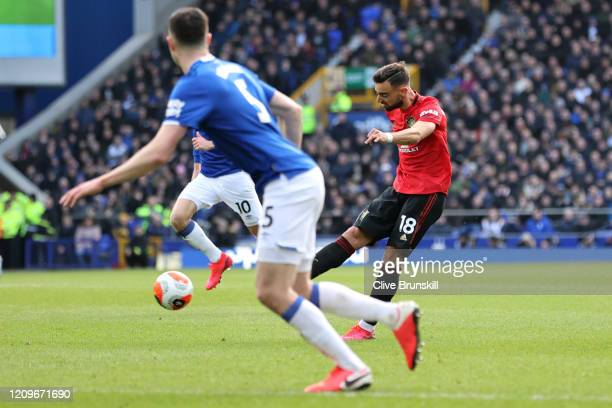Bruno Fernandes of Manchester United scores his team's first goal during the Premier League match between Everton FC and Manchester United at...