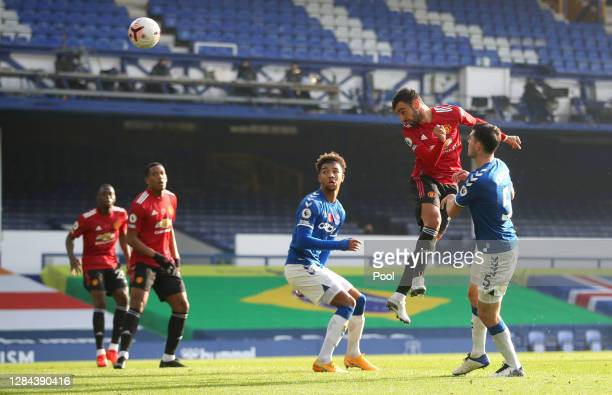 Bruno Fernandes of Manchester United scores his team's first goal during the Premier League match between Everton and Manchester United at Goodison...