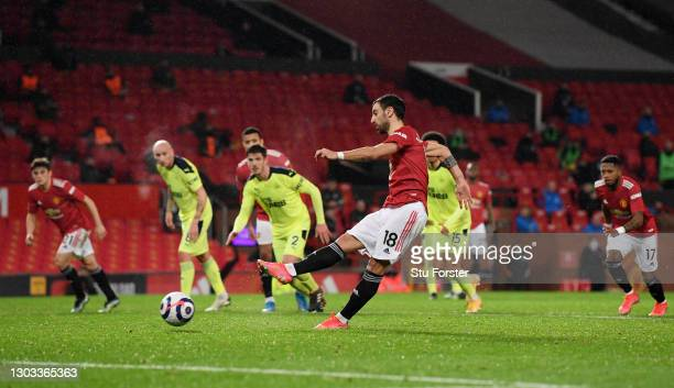Bruno Fernandes of Manchester United scores his team's third goal from the penalty spot during the Premier League match between Manchester United and...