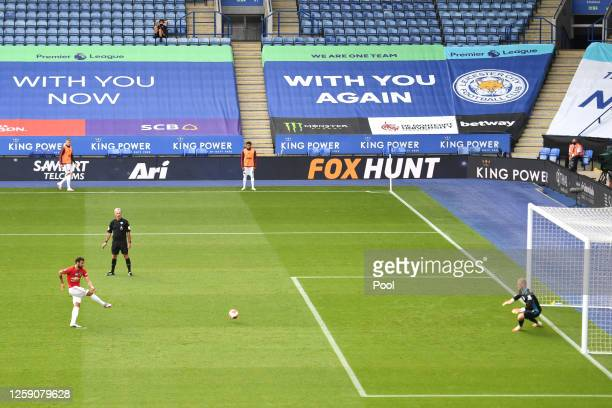 Bruno Fernandes of Manchester United scores the opening goal from the penalty spot during the Premier League match between Leicester City and...