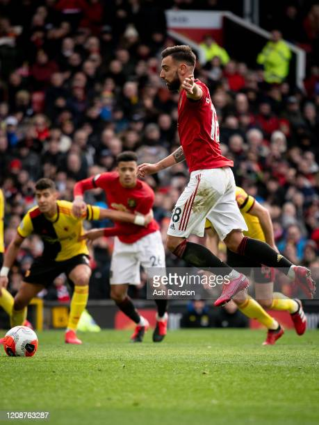 Bruno Fernandes of Manchester United scores their first goal during the Premier League match between Manchester United and Watford FC at Old Trafford...