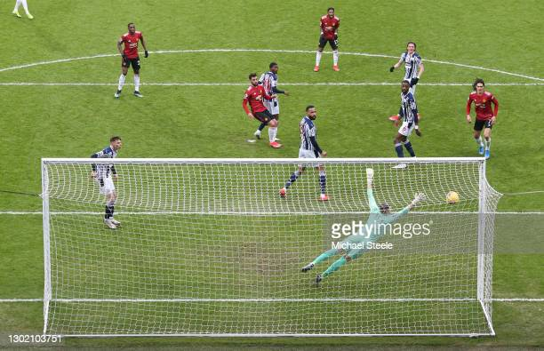 Bruno Fernandes of Manchester United scores their side's first goal during the Premier League match between West Bromwich Albion and Manchester...
