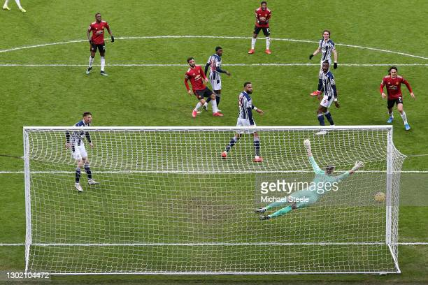 Bruno Fernandes of Manchester United scores their side's first goal past Sam Johnstone of West Bromwich Albion during the Premier League match...