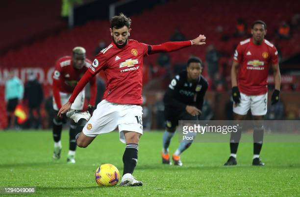 Bruno Fernandes of Manchester United scores their team's second goal from the penalty spot during the Premier League match between Manchester United...