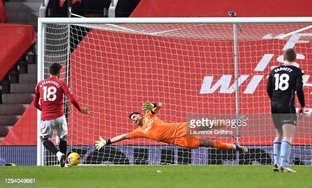 Bruno Fernandes of Manchester United scores their team's second goal from the penalty spot past Emiliano Martinez of Aston Villa during the Premier...