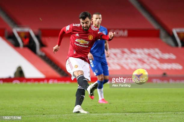 Bruno Fernandes of Manchester United scores their team's second goal during the Premier League match between Manchester United and Everton at Old...