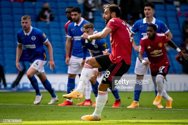 Bruno Fernandes of Manchester United scores their third goal during the Premier League match between Brighton & Hove Albion and Manchester United at...