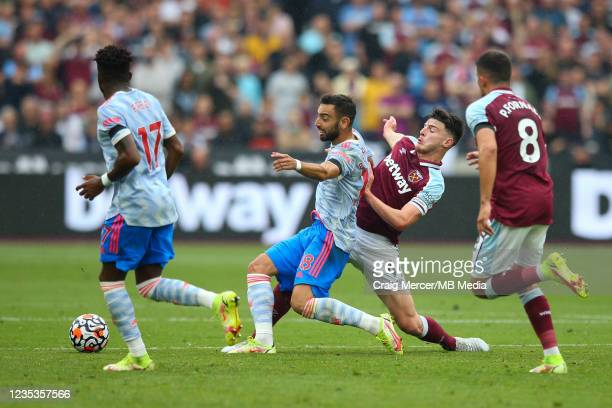 Bruno Fernandes of Manchester United under pressure from Declan Rice of West Ham United during the Premier League match between West Ham United and...