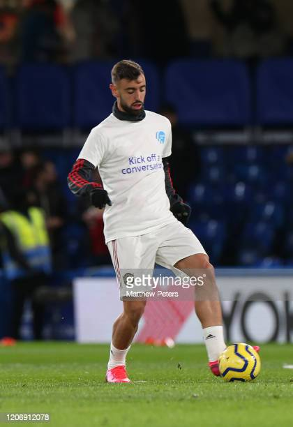Bruno Fernandes of Manchester United warms up ahead of the Premier League match between Chelsea FC and Manchester United at Stamford Bridge on...