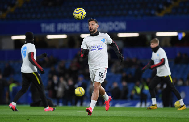 Bruno Fernandes of Manchester United warms up in a 'Heads Up Campaign' tshirt the Premier League match between Chelsea FC and Manchester United at...