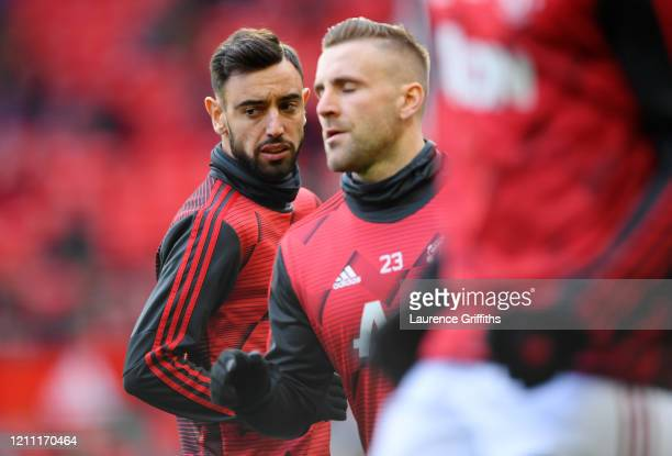 Bruno Fernandes of Manchester United warms up with Luke Shaw of Manchester United ahead of the Premier League match between Manchester United and...