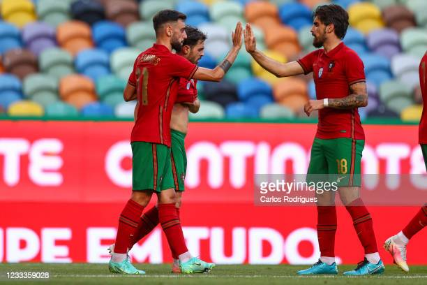 Bruno Fernandes of Portugal and Manchester United celebrates scoring Portugal first goal with his team mates during the international friendly match...