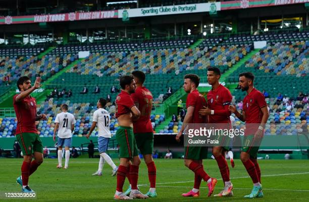 Bruno Fernandes of Portugal and Manchester United celebrates with teammates after scoring a goal during the International Friendly match between...