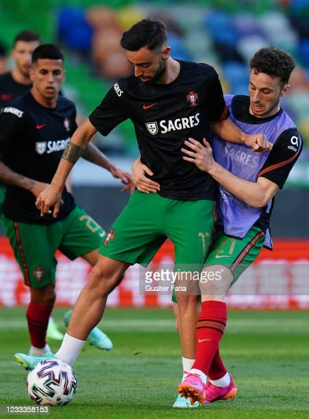 Bruno Fernandes of Portugal and Manchester United with Diogo Jota of Portugal and Liverpool FC in action during warm up before the start of the...