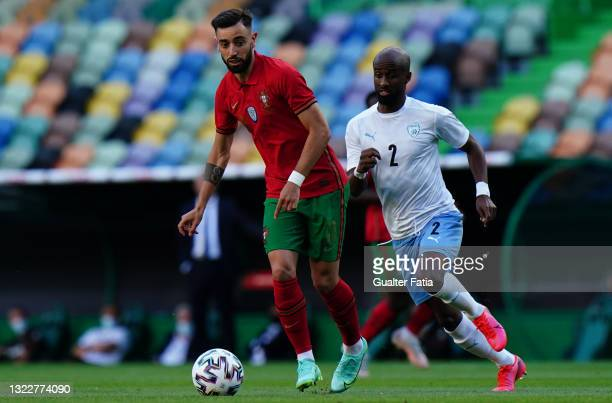 Bruno Fernandes of Portugal and Manchester United with Eliazer Dasa of Israel in action during the International Friendly match between Portugal and...