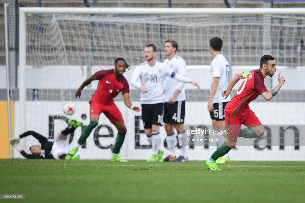Bruno Fernandes of Portugal (R) celebrates after scoring a goal to make it 0-1 during the U21 International Friendly match between Germany U21 and Portugal U21 at Gazi-Stadion auf der Waldau on March 28, 2017 in Stuttgart, Germany.