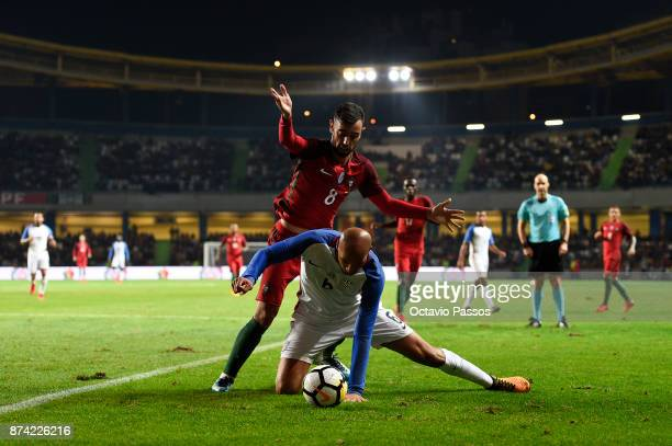 Bruno Fernandes of Portugal competes for the ball with John Brooks of USA during the International Friendly match between Portugal and USA at Estadio...