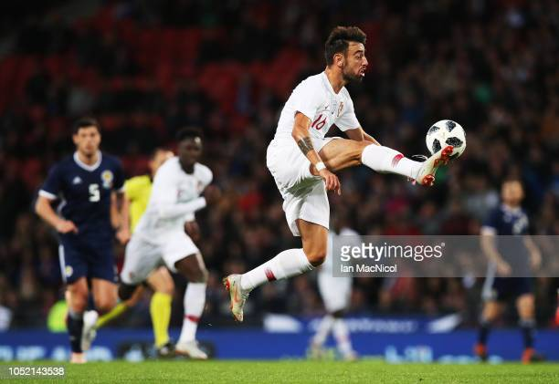 Bruno Fernandes of Portugal controls the ball during the International Friendly match between Scotland and Portugal on October 14 2018 in Glasgow...
