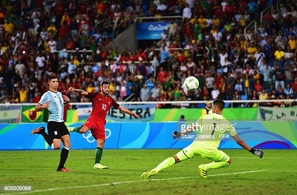 Bruno Fernandes of Portugal has a shot saved by Geronimo Rulli of Argentina during the Olympic Men's Football match between Portugal and Argentina at...