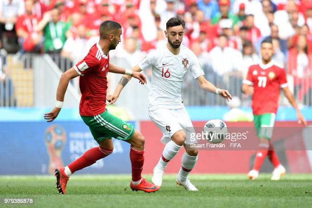 Bruno Fernandes of Portugal is challenged by Hakim Ziyach of Morocco during the 2018 FIFA World Cup Russia group B match between Portugal and Morocco...