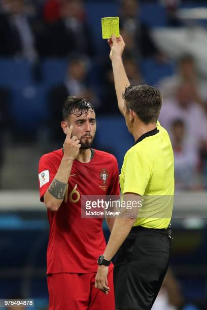 Bruno Fernandes of Portugal is shown a yellow card by Referee Gianluca Rocchi during the 2018 FIFA World Cup Russia group B match between Portugal...