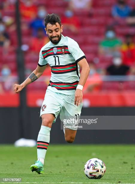 Bruno Fernandes of Portugal runs with the ball during the international friendly match between Spain and Portugal at Wanda Metropolitano stadium on...