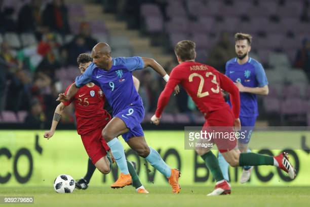 Bruno Fernandes of Portugal Ryan Babel of Holland Adrien Silva of Portugal Davy Propper of Holland during the International friendly match match...