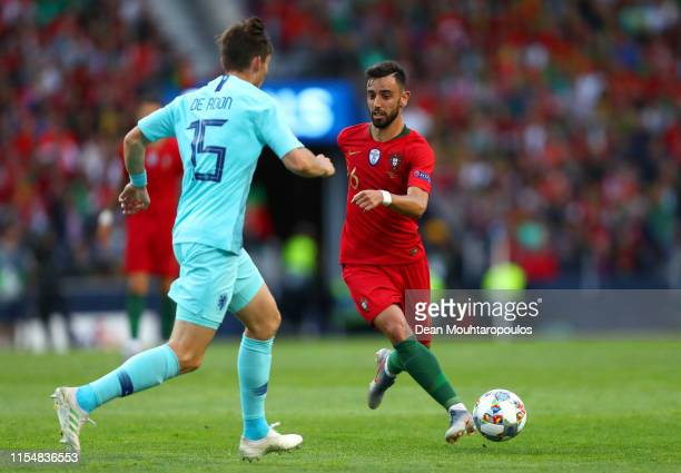 Bruno Fernandes of Portugal takes on Marten de Roon of the Netherlands during the UEFA Nations League Final between Portugal and the Netherlands at...