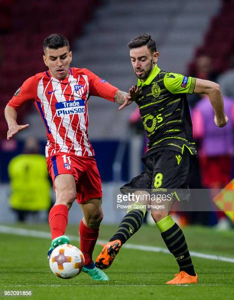 Bruno Fernandes of Sporting CP fights for the ball with Angel Correa of Atletico de Madrid during the UEFA Europa League quarter final leg one match...