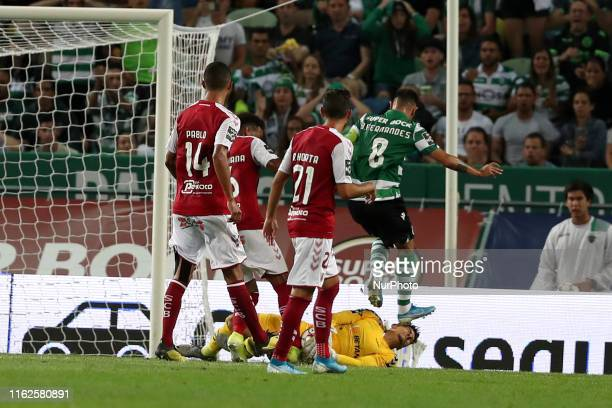 Bruno Fernandes of Sporting CP hits the face of Matheus Magalhaes of SC Braga during the Portuguese League football match between Sporting CP and SC...
