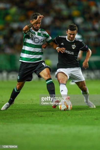 Bruno Fernandes of Sporting CP vies with Gara Garayev of Qarabag FK for the ball possession during the UEFA Europa League Group E match between...