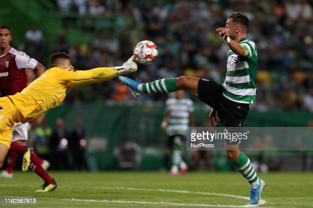 Bruno Fernandes of Sporting CP vies with Matheus Magalhaes of SC Braga during the Portuguese League football match between Sporting CP and SC Braga...