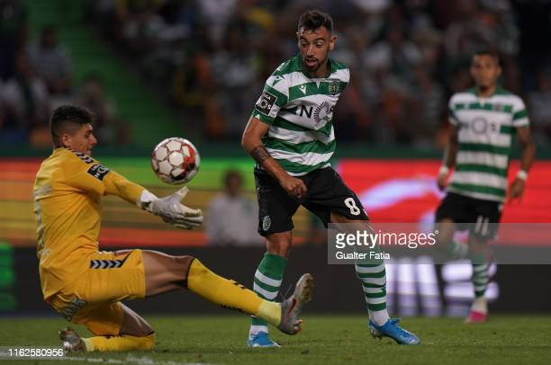 Bruno Fernandes of Sporting CP with Matheus Magalhaes of SC Braga in action during the Liga NOS match between Sporting CP and SC Braga at Estadio...