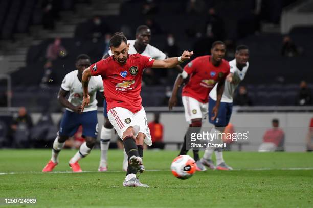 Bruno Fernandes scores his sides first goal from the penalty spot during the Premier League match between Tottenham Hotspur and Manchester United at...