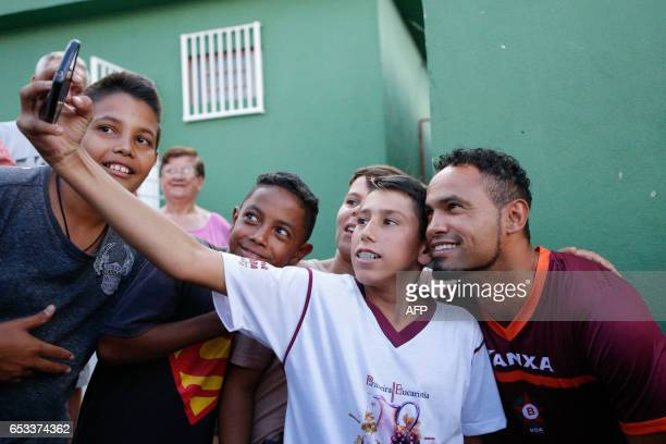 Bruno Fernandes takes pictures with fans during his presentation as the new BOA Esporte goalkeeper at the club's headquarters in the city of Varginha...