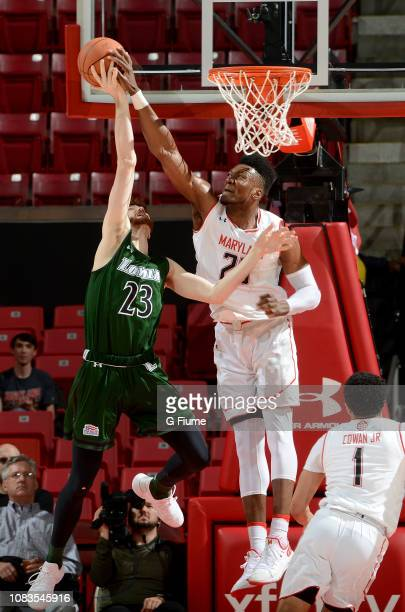 Bruno Fernando of the Maryland Terrapins blocks a shot by Brent Holcombe of the Loyola Greyhounds at Xfinity Center on December 11 2018 in College...