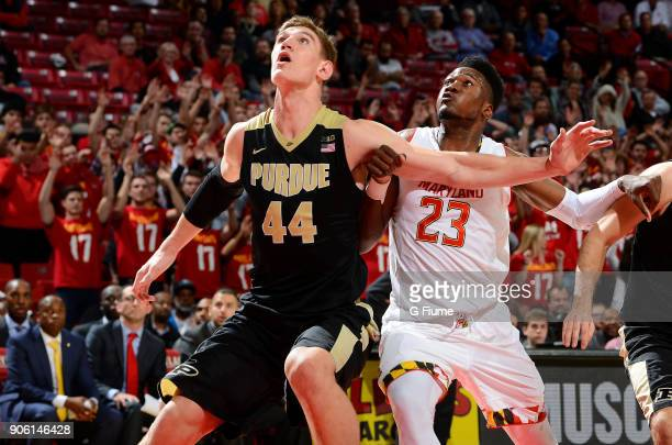 Bruno Fernando of the Maryland Terrapins boxes out against Isaac Haas of the Purdue Boilermakers at Xfinity Center on December 1 2017 in College Park...