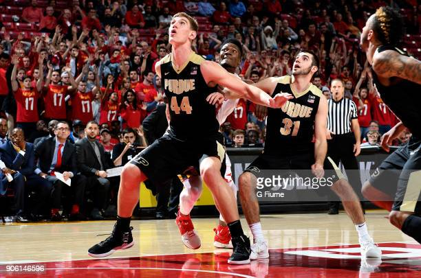 Bruno Fernando of the Maryland Terrapins boxes out against Isaac Haas and Dakota Mathias of the Purdue Boilermakers at Xfinity Center on December 1...