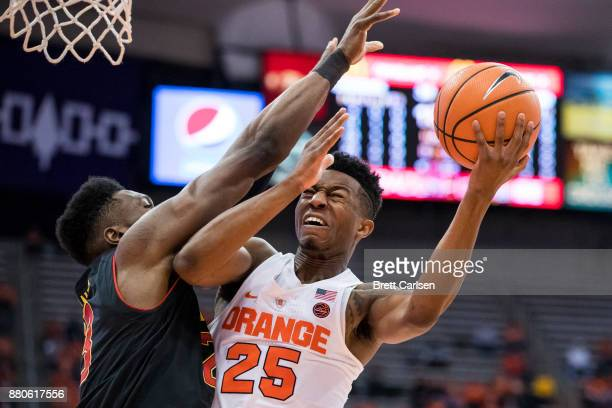 Bruno Fernando of the Maryland Terrapins defends as Tyus Battle of the Syracuse Orange drives to the basket for a lay up during the second half at...