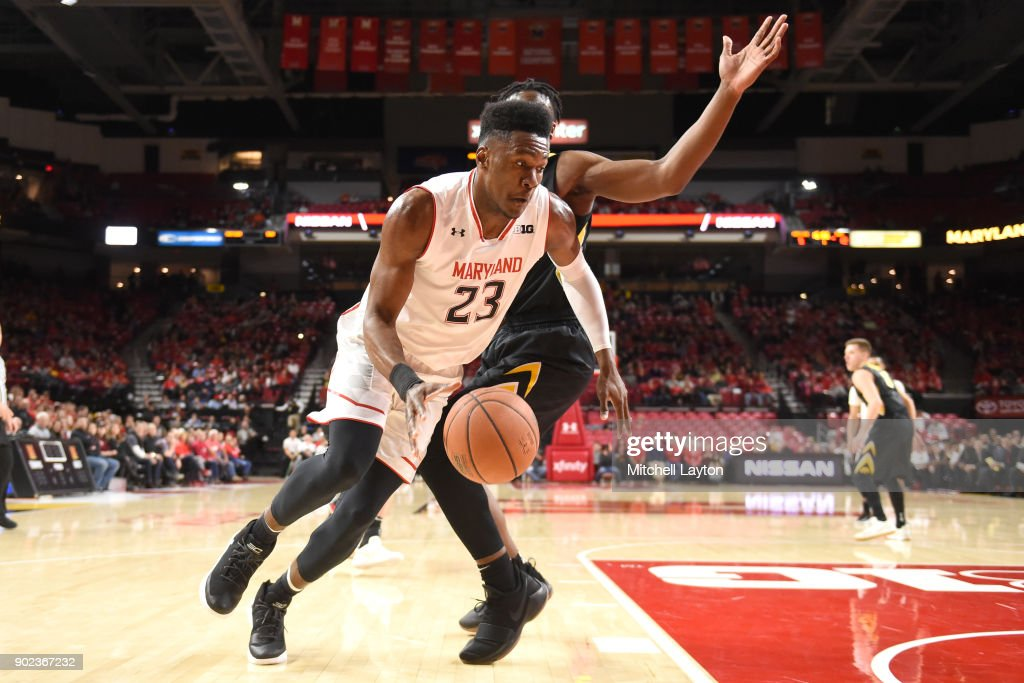 Bruno Fernando #23 of the Maryland Terrapins dribbles around Tyler Cook #5 of the Iowa Hawkeyes during a college basketball game at the XFinity Center on January 7, 2018 in College Park, Maryland.